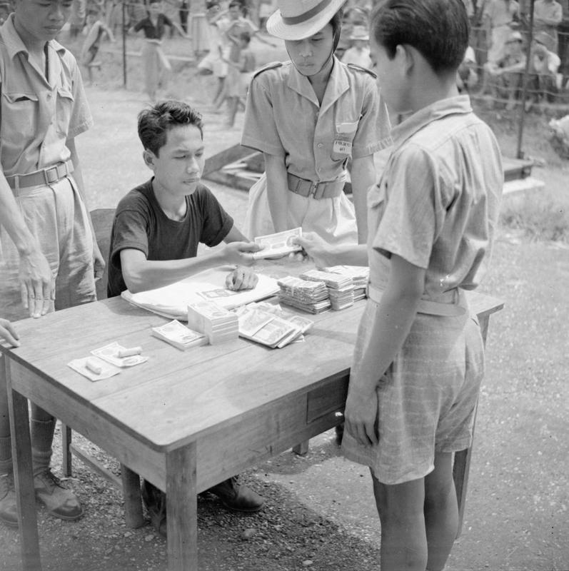 Exchanging  currency issued during the Japanese Occupation in the village of Lantja, on the east coast of Celebes.