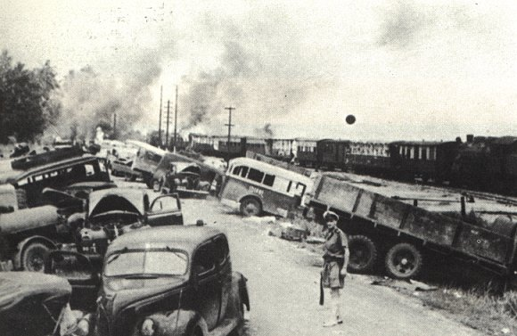 Destruction of trucks at port of Oosthaven, Sumatra Island 1942